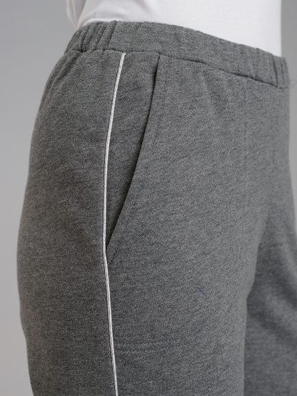карман на женских брюках